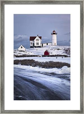 Nubble Lighthouse In The Snow Framed Print by Eric Gendron