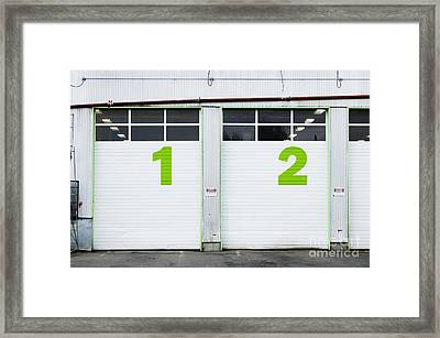 Numbers On Repair Shop Bay Doors Framed Print by Don Mason