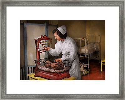Nurse - The Pediatrics Ward 1943 Framed Print by Mike Savad