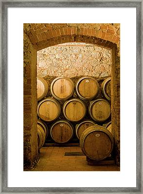 Oak Barrels In Chianti Wine Cellar, Italy Framed Print by Petr Svarc