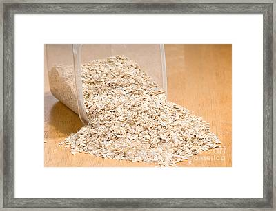 Oat Flakes Spilled Out Of Plastic Container  Framed Print by Arletta Cwalina