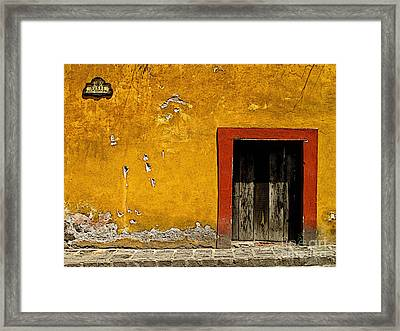 Ochre Wall With Red Door Framed Print by Mexicolors Art Photography