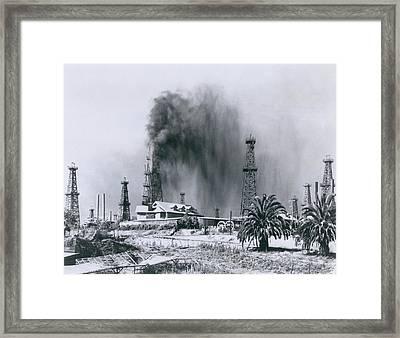 Oil Gusher At Signal Hill In California Framed Print by Everett
