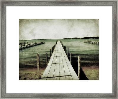 Okoboji Docks Framed Print by Julie Hamilton