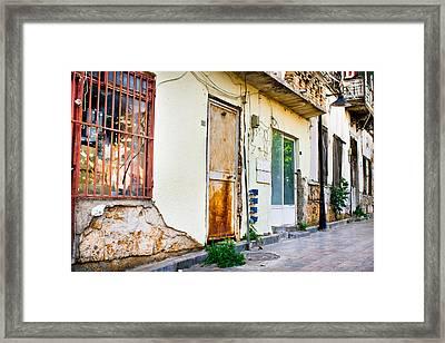 Old Buildings Framed Print by Tom Gowanlock