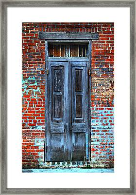 Old Door With Bricks Framed Print by Perry Webster
