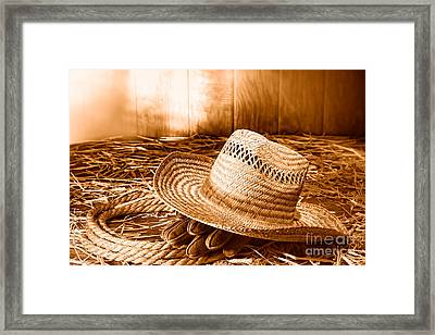 Old Farmer Hat In Hay Barn - Sepia Framed Print by Olivier Le Queinec