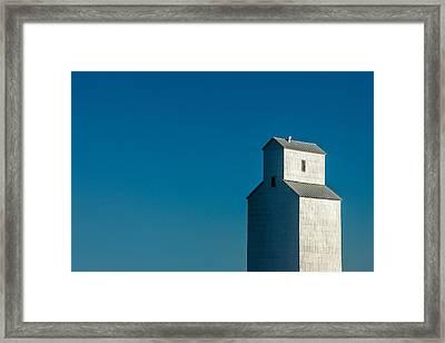 Old Grain Elevator Against Steel Blue Sky Framed Print by Todd Klassy