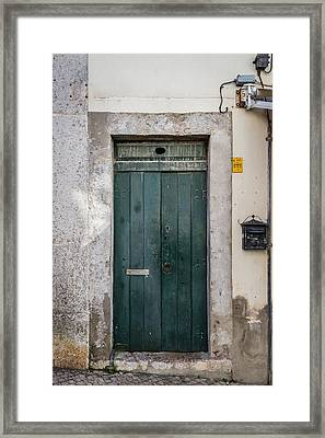 Old Green Door Framed Print by Marco Oliveira