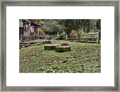 Old Grindstone Framed Print by Paul Ward