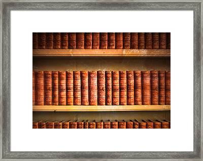 Old Library Framed Print by Tom Gowanlock