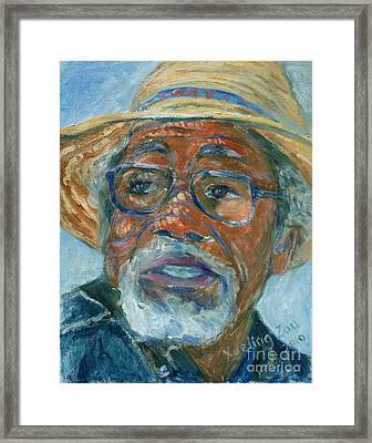 Old Man Wearing A Hat Framed Print by Xueling Zou