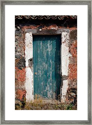 Old Painted Door Framed Print by Gaspar Avila