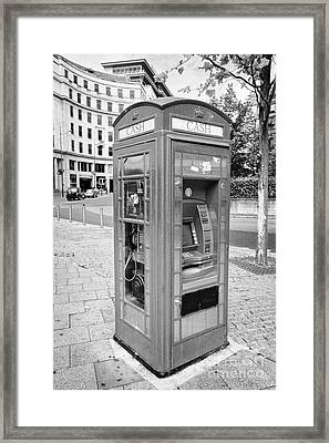old red telephone box converted into a phone box and atm cash machine Birmingham UK Framed Print by Joe Fox