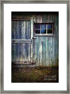 Old Shed Door With Spooky Shadow In Window Framed Print by Sandra Cunningham