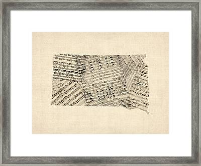 Old Sheet Music Map Of South Dakota Framed Print by Michael Tompsett