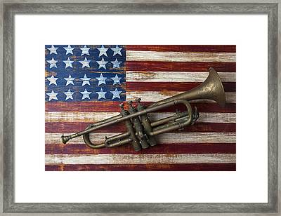 Old Trumpet On American Flag Framed Print by Garry Gay