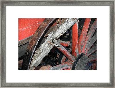 Old Wagon Wheel Framed Print by Dennis  Rundlett