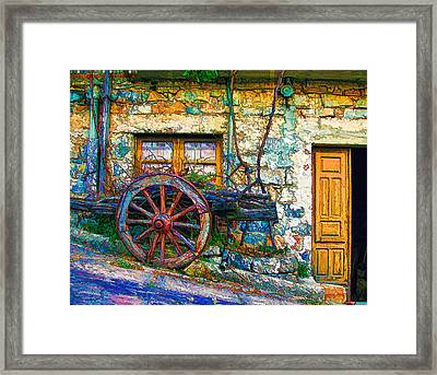 Old Wagon Wheel Framed Print by Lanjee Chee