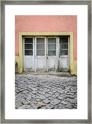 Old Weathered Door Framed Print by Marco Oliveira