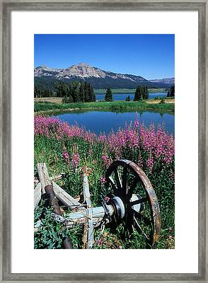 Old Wheel And Brooks Lake Framed Print by Kathy Yates
