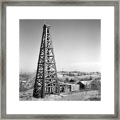 Old Wooden Derrick Framed Print by Larry Keahey