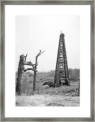 Old Wooden Oil Derrick Framed Print by Larry Keahey