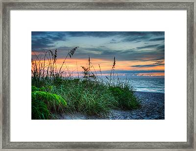 On The Edge Of Sunrise Framed Print by Debra and Dave Vanderlaan