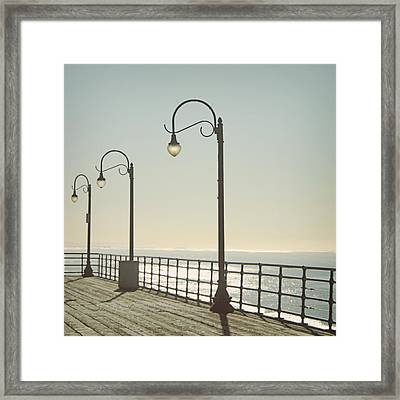 On The Pier Framed Print by Linda Woods