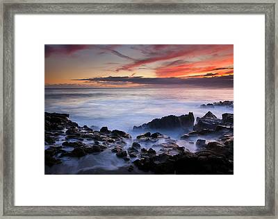 On The Red Rocks Framed Print by Mike  Dawson
