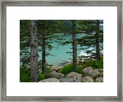 On The Shore Of Lake Louise Framed Print by Connie Handscomb
