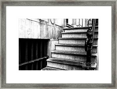 One Step At A Time In Amsterdam Mono Framed Print by John Rizzuto