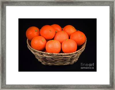 Oranges In A Basket Framed Print by Ray Shrewsberry