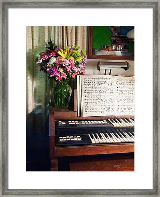 Organ And Bouquet Of Flowers Framed Print by Susan Savad