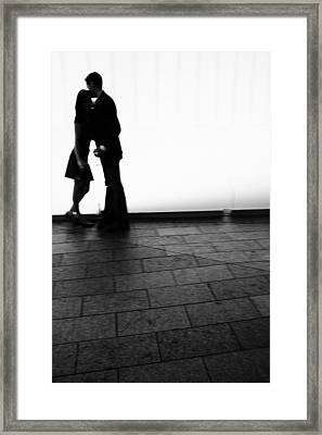 Out Of Focus Couple Kissing Framed Print by Gillham Studios