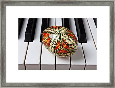 Painted Easter Egg On Piano Keys Framed Print by Garry Gay