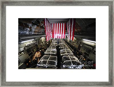Pallets Of Cargo Inside Of A C-17 Framed Print by Stocktrek Images