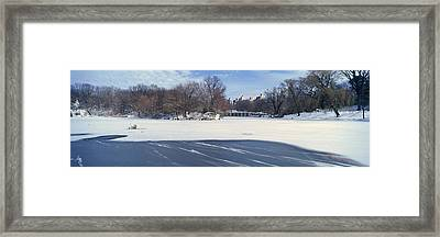 Panoramic View Of Frozen Pond Framed Print by Panoramic Images