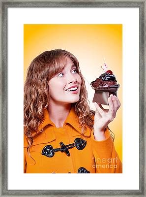 Party Woman Holding Birthday Cake With Lit Candle Framed Print by Jorgo Photography - Wall Art Gallery