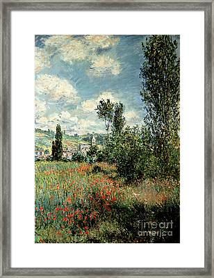 Path Through The Poppies Framed Print by Claude Monet