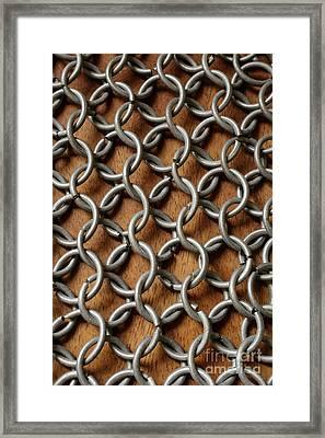 Pattern Of Metal Rings Framed Print by Edward Fielding