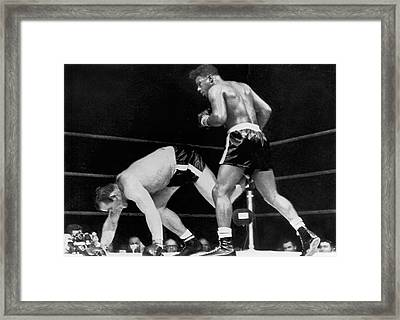 Patterson Beats Johansson Framed Print by Underwood Archives