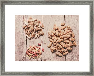 Peanut Shelling Framed Print by Jorgo Photography - Wall Art Gallery