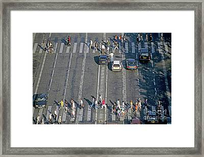 Pedestrians On A Zebra Crossing On The Champs-elysees Framed Print by Sami Sarkis