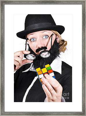 Person Holding Eyeglasses Showing Cube Puzzle Framed Print by Jorgo Photography - Wall Art Gallery