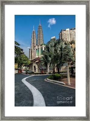 Petronas Towers Framed Print by Adrian Evans