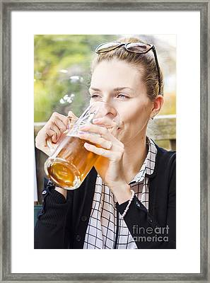 Petty Woman Drinking Beer Stein During Oktoberfest Framed Print by Jorgo Photography - Wall Art Gallery