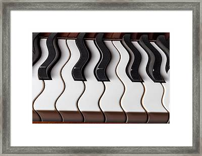 Piano Keyboard Waves Framed Print by Garry Gay