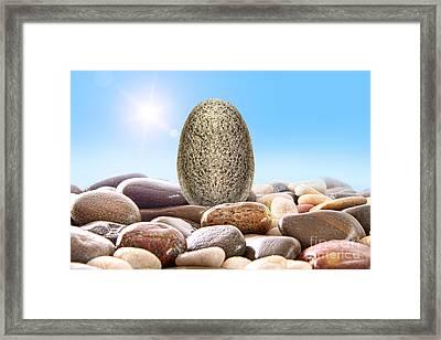 Pile Of River Rocks On White Framed Print by Sandra Cunningham