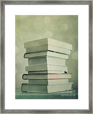 Piled Reading Matter Framed Print by Priska Wettstein
